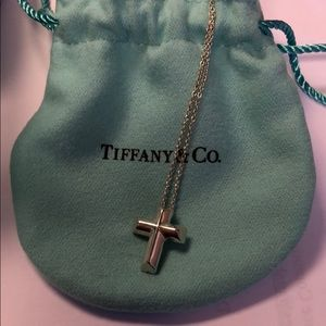 Tiffany & Co. tenderness heart cross necklace.